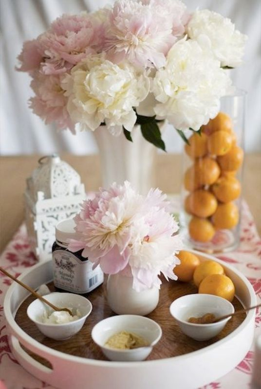 a tray with various masks, blush and neutral blooms and citrus for decor or to add to the masks