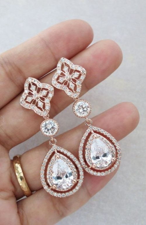 elegant statement earrings given in the morning can be worn during the wedding day and will be a very memorable gift