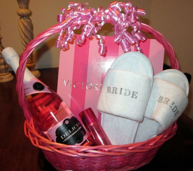 Best Wedding Gift For Girl: Picture Of A Pink Basket With Slippers, Wine, A Perfume