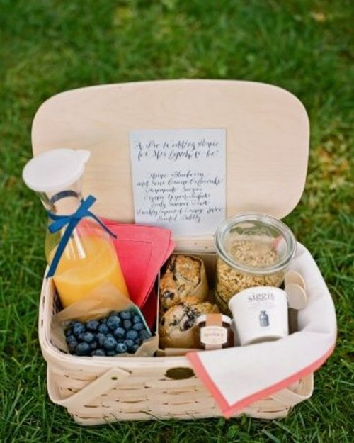 a breakfast basket with berries, muffins, granola and juice to have a nice meal in the morning