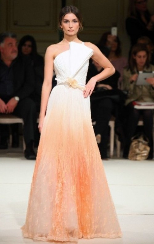 a strapless wedding ballgown in white and peachy pink, with a sculptural detail on the bodice