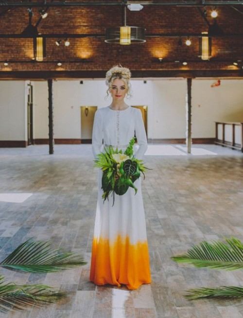 a boho dip dye wedding dress in white and yellow and with lace inserts for a statement-like boho look