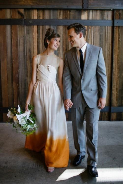 a sleeveless dip dye wedding dress with a textural bodice, a dip dye yellow skirt and an illusion neckline