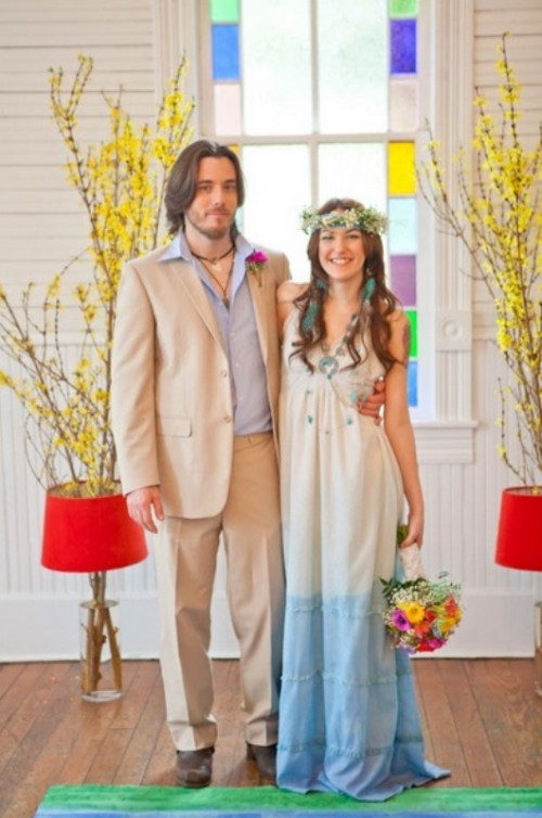 a creative dip dye blue wedding dress plus a necklace and a floral crown for a lovely boho bridal look