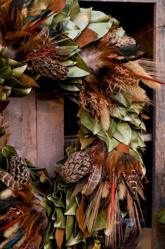 Decorative holiday wreath made of feathers and pine needles.