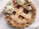 a fruit and berry pie topped with fresh blooms is a nice boho alternative to a usual formal wedding cake