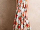 a spaghetti strap midi dress with a bright floral print and nude heels plus a statement necklace