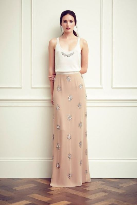 a romantic look with a white embellished top and a tan embellished maxi skirt