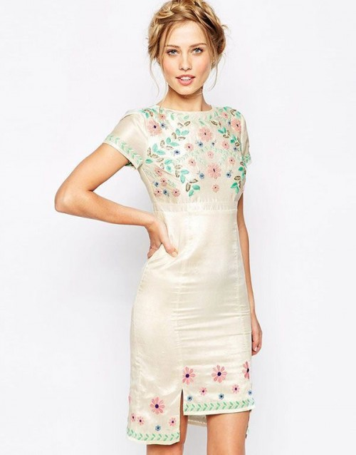 an embroidered floral mini dress with short sleeves and a high neckline for a boho bride-to-be