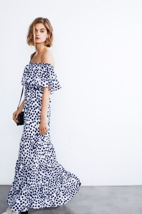 an off the shoulder printed maxi dress with a black cross body is a chic modern option to try