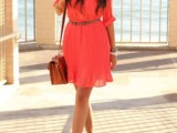 a neon pink knee dress with long sleeves, a belt and platform shoes plus an amber bag for summer