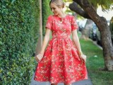 a red knee A-line floral dress with short sleeves and a high neckline is a very girlish idea