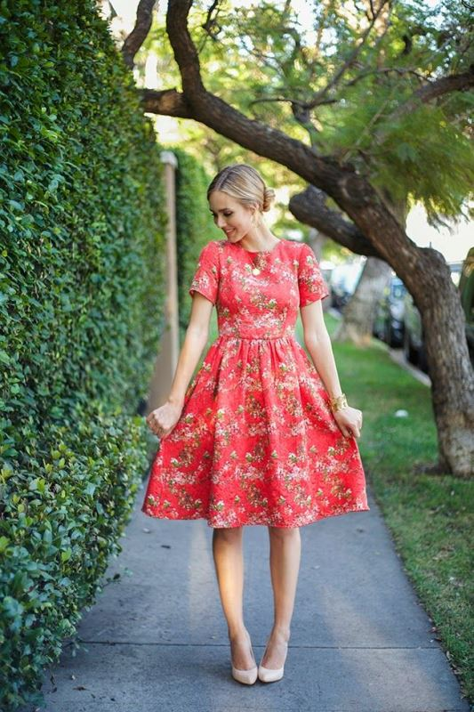 a red knee A line floral dress with short sleeves and a high neckline is a very girlish idea