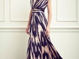 a bold printed sleeveless maxi dress with a deep neckline and embellished shoulders for a comfortable and chic look