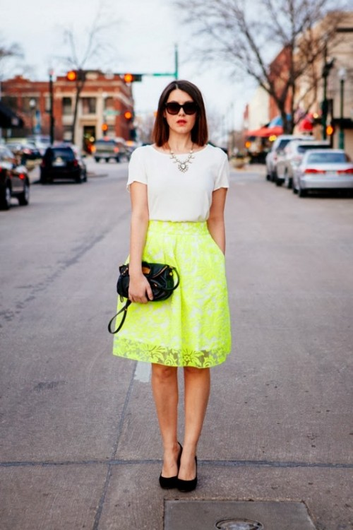 a simple look with a trendy neon green skirt with pockets, a white t-shirt, a statement necklace, black shoes and a clutch