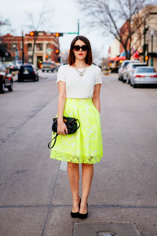 a simple look with a trendy neon green skirt with pockets, a white t shirt, a statement necklace, black shoes and a clutch