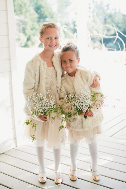 neutral tulle mini dress, neutral faux fur coveurps, white tights and tan shoes for a heavenly beautiful winter flower girl look