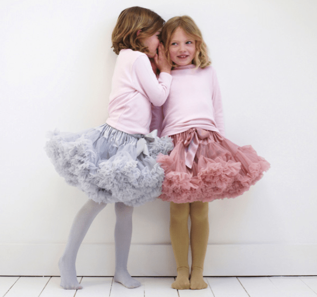 pink long sleeve tops, pink and blue tull over the knee skirts and tights for fun and whimsy modern winter flower girls