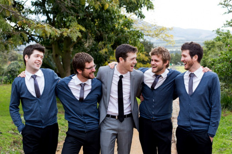 Picture Of smart casual looks with sweaters for a groom and his men  5