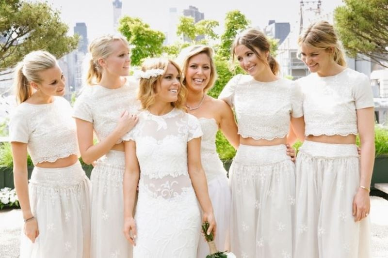 white bridal outfits with maxi pleated skirts and lace crop tops with short sleeves plus a high neckline look very trendy