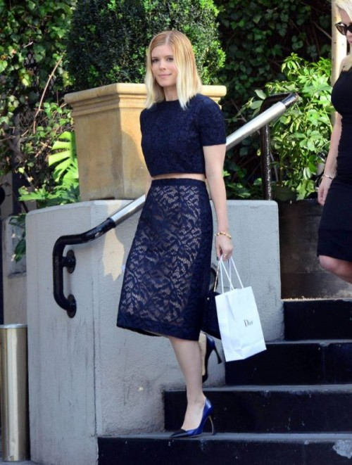 a navy combo of a lace crop top with a high neckline and short sleeves and a midi pencil skirt plus blue shoes