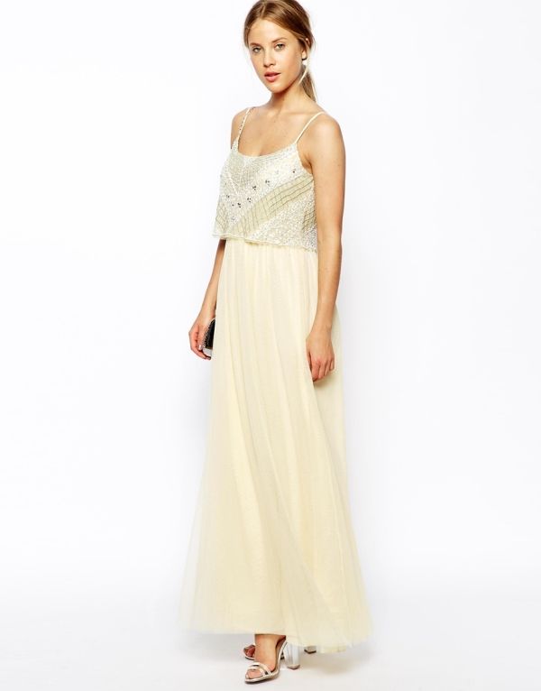 a romantic look with an embellished crop top, a neutral high waist skirt and silver shoes