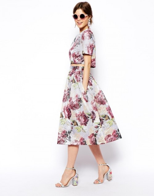 a floral ensemble with a crop top with short sleeves and an A-line midi skirt plus floral shoes for a bridesmaid
