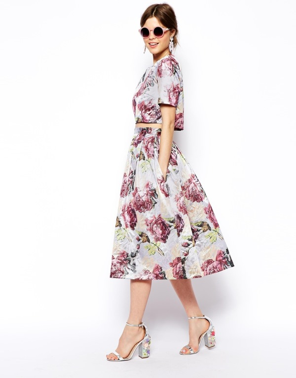 a floral ensemble with a crop top with short sleeves and an A line midi skirt plus floral shoes for a bridesmaid
