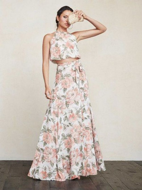 a floral outfit with a halter neckline crop top and a maxi skirt for a spring or summer wedding