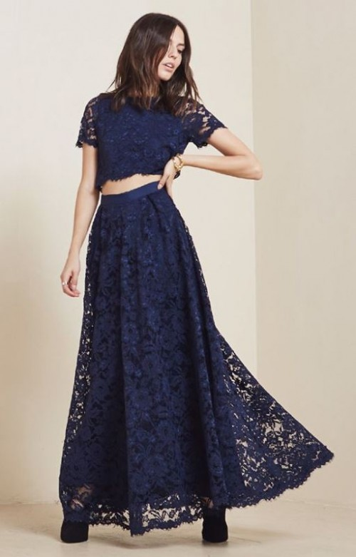 a navy lace ensemble with a crop top with short sleeves and a maxi skirt looks bold and statement-like