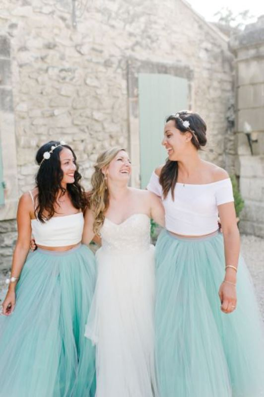 mint tulle maxi skirts paired with mismatching white crop tops look bold and fun and fit spring or summer weddings