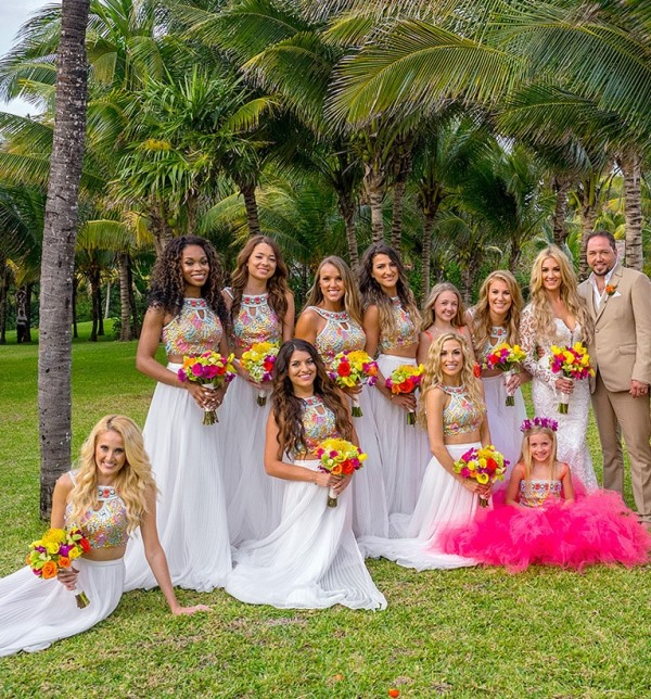 bright bridesmaid looks with colorful embellished halter neckline crop tops and white maxi skirts for a tropical wedding