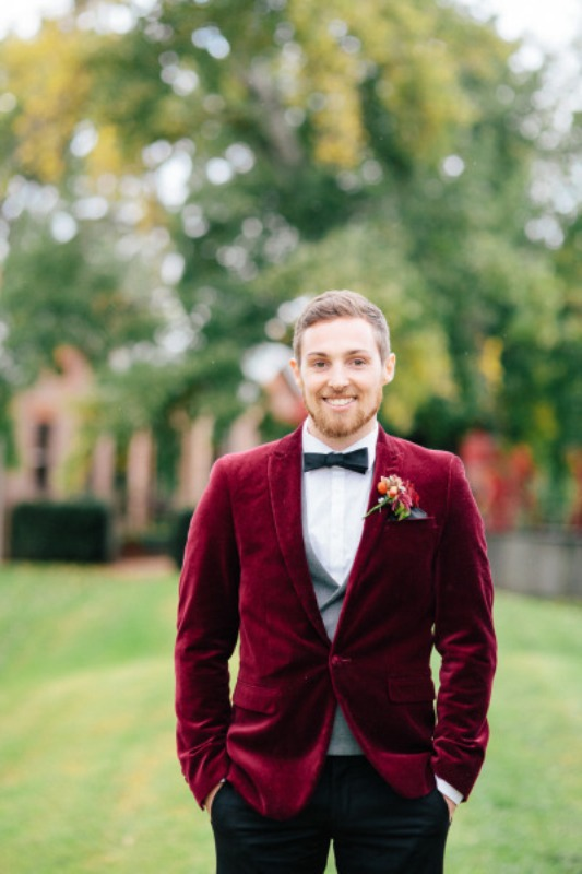 a burgundy velvet blazer, black pants, a white shirt and a black bow tie for a stylish and comfortable fall outfit