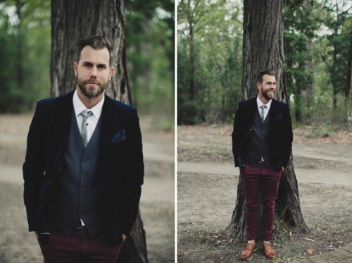 a bold groom's outfit with burgundy velvet pants, a grey waistcoat, a navy velvet blazer and a light grey tie