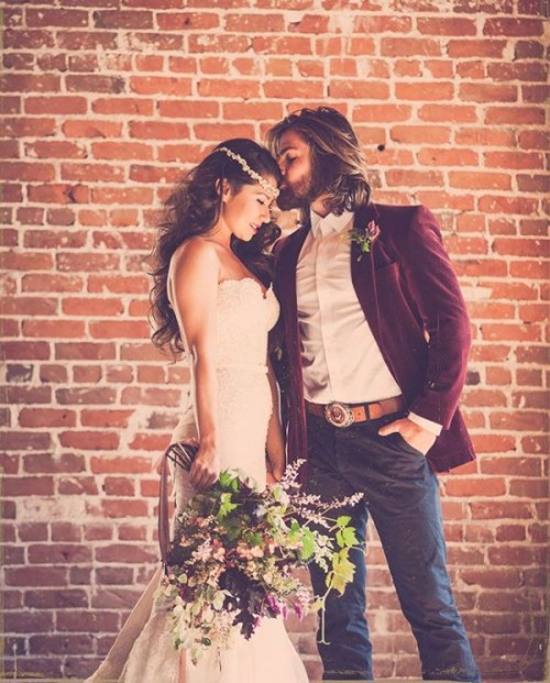 a relaxed boho groom's look with grey pants, a burgundy velvet blazer and a white shirt for the fall