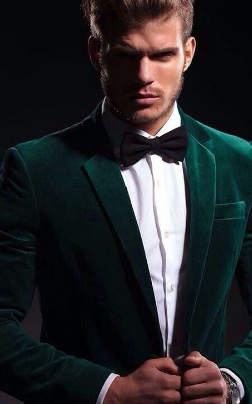 a bright and chic outfit with an emerald velvet blazer and black bow tie is amazing for a fall or NYE wedding
