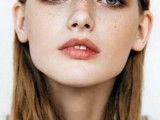 a nude-style makeup with a matte pink lip, brown smokeys, fresh and shiny skin and accented green eyes