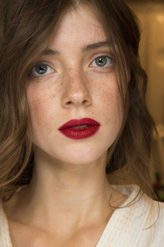 a bold makeup with slightly accented eyes, blush and a bold lip for a statement