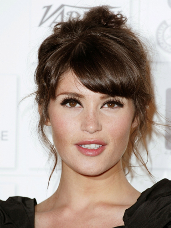 a natural makeup with a glossy pink lip, blushes and extended eyelashes plus eyeliner to accent the eyes as much as possible