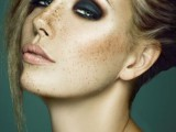a bold rock-style makeup with dark smokeys, a glossy pink lip, fresh and shiny skin is a statement