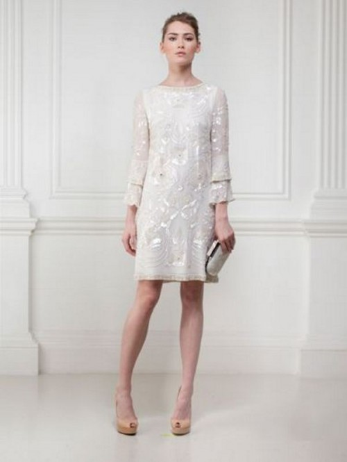 a pretty retro-inspired embellished wedding dress with bell sleeves, a high neckline and metallic accessories for a glam look