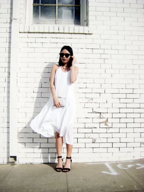 a simple and pretty white A-line midi wedding dress , a statement necklace and bracelet and black heels