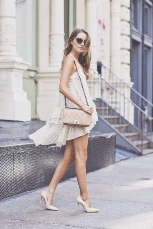 an off-white net high low knee wedding dress with a ruffle tier skirt, nude shoes and a blush bag for a modern and simple look