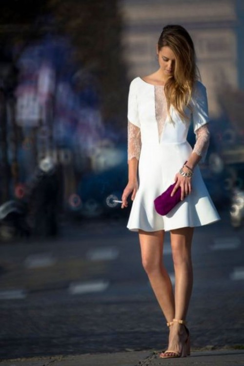 a statement a-line plain mini wedding dress with lace sleeves and a plunging neckline covered with lace, nude heels and a fuchsia clutch for a bold look