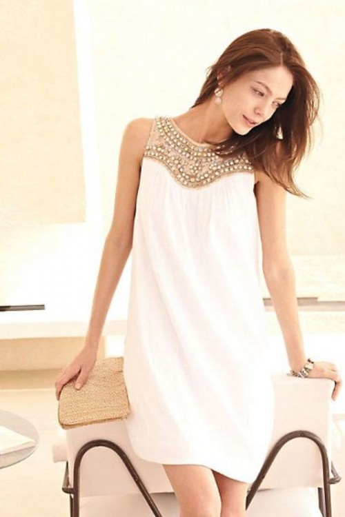 a pretty A-line mini dress with a fully embellished neckline looks glam and folksy at the same time