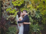 a lush living greenery wall with lots of succulents and statement plants and moss is a gorgeous wedding ceremony backdrop with a modern feel