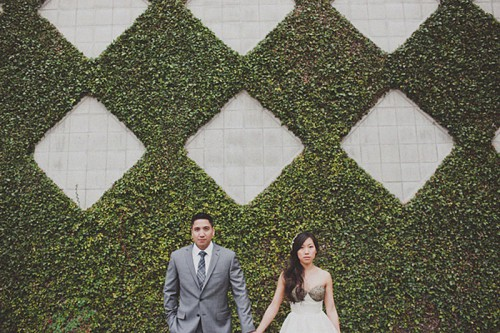 a greenery wall with tile geometric patterns is an amazing idea for a modern garden wedding