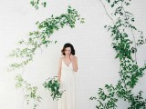 a white brick wall and some greenery on it will create an airy and light-filled backdrop for your wedding ceremony