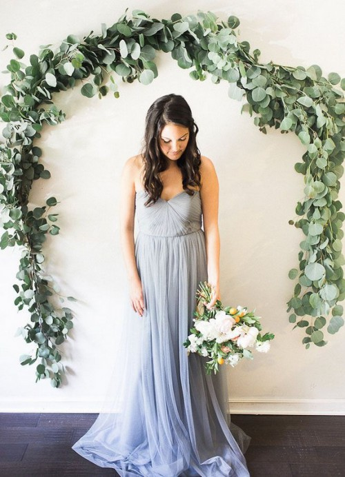 a fresh eucalyptus wedding arch attached to the wall is an easy idea to save some space and you can DIY one easily saving money