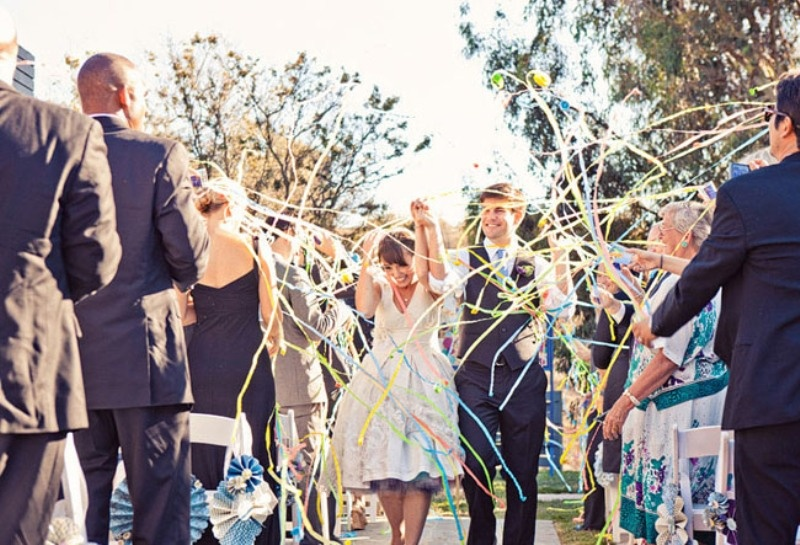 colorful paper ribbons can be also reused after the wedding, which is a great eco friendly idea